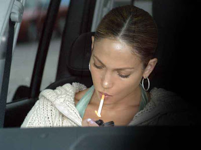 Jennifer Lopez lighting a cigarette.