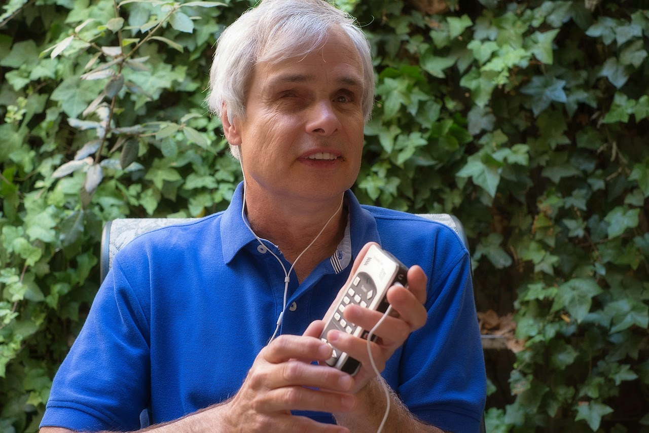 A Bookshare member reading a Bookshare book in audio format on an assistive technology device.