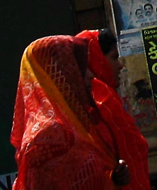 Close up of women with saris pallav covering their heads