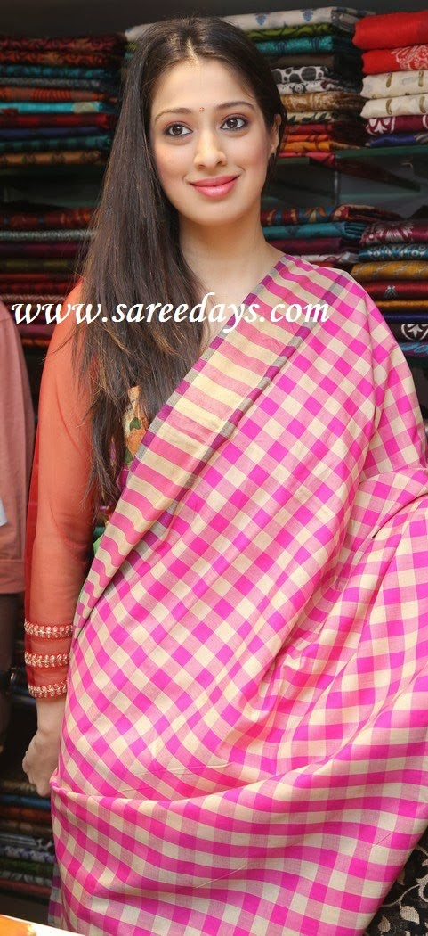 Latest saree designs lakshmi rai in pink uppada saree checkout lakshmi rai displaying designer pink uppada saree with checked design and with mustard checked border altavistaventures Image collections