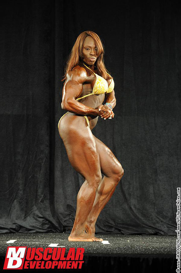 Victoria Dominguez Flexing Her Muscles At The 2012 IFBB North American Championships
