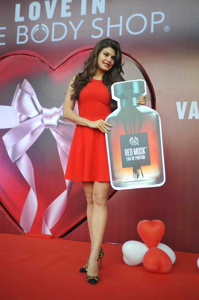 Actress Jacqueline Fernandez Latest Cute Hot Red Mini Skirt Dress Spicy Thighs Show Photos Gallery At The Body Shop Launch