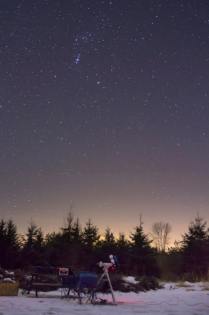 Orion is seen in the night sky above my telescope in February