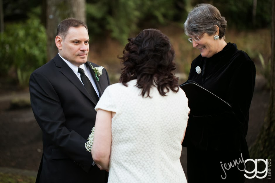 Linda and David hold hands during their wedding ceremony - Posted by Patricia Stimac, Seattle Wedding Officiant