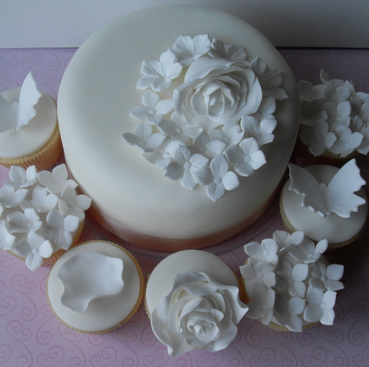 White Wedding Cake and Cupcakes