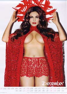 Kelly Brook shows off her famous cleavage in a skimpy red outfit