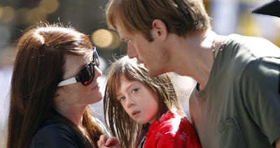 Julianne Moore and Alexander Skarsgard in What Maisie Knew
