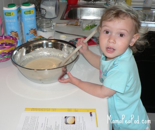 little kids help in the kitchen - stirring