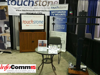 Touchstone Home Products showcases state-of-the-art TV lift cabinets and Whisper Lift II Pro Advanced  TV Lifts at InfoComm15 in Orlando, Florida.