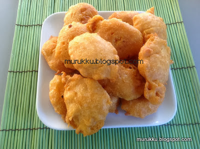 potato slices are dipped in gram flour batter and deep fried