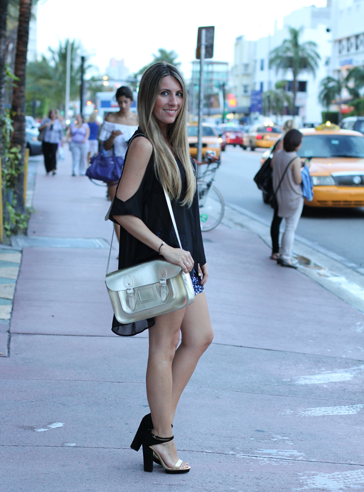 Outfit for Miami Fashion Week with paillettes shorts and tail hem blouse