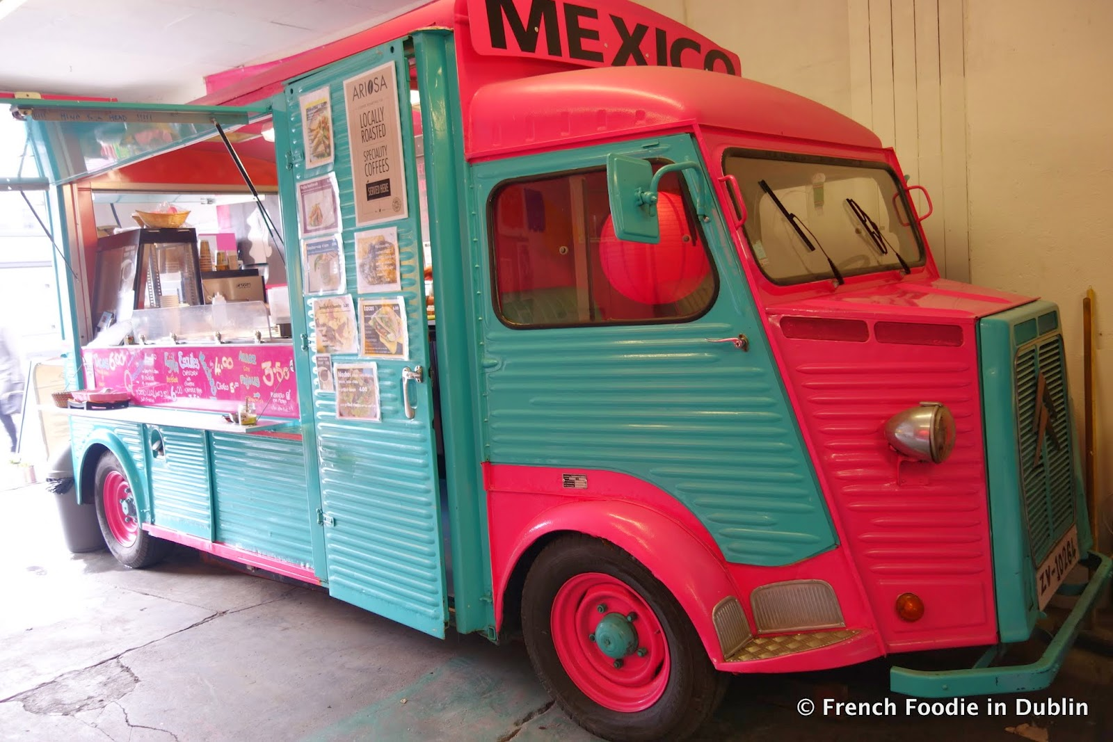The Vintage Truck Painted In Pink And Turquoise Is Totally Cute