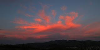 As night falls, the clouds burn