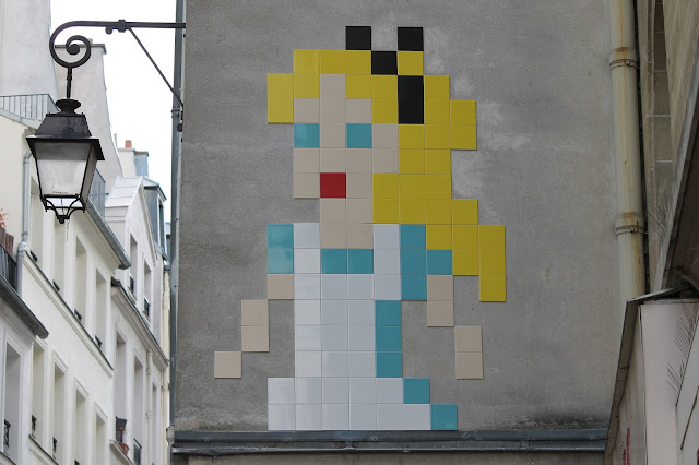 """After a smiley version of Napoleon a couple days ago, Invader is once again back on the streets of Paris with a brand new pixelated design. The anonymous French artist created this large-scale rendering of Alice In Wonderland using mosaic tiles, a design which is now known as """"PA_1170""""."""