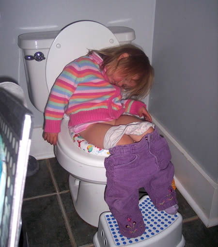 funny baby sleeping in toilet