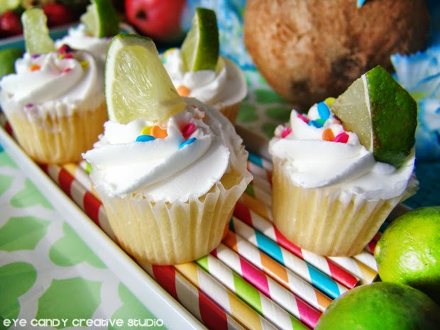 luau party food, mini vanilla cupcakes, lime slices, tropical fruit, coconut