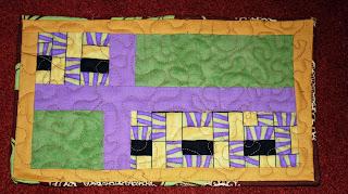 http://2.bp.blogspot.com/_-1uiHOP1z9E/TT34rmOu5qI/AAAAAAAAApk/OLkZwES49RQ/s320/Mug+rug+-+front.jpg