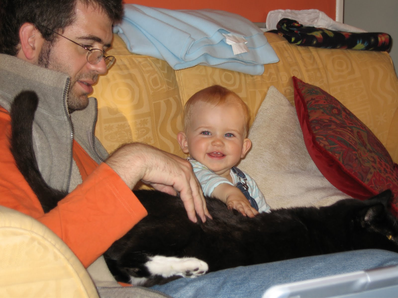 family huddle learning to pet stroke the cat with daddy 9 nine month baby girl is all smiles sitting on the sofa with a cushion or two 1 JR FETISH PORN FORUM   Fetish Porn, pissing porn, BDSM porn, pantyhose porn,
