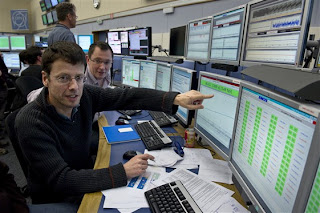 CERN Operations Group leader Mike Lamont (foreground) and LHC engineer in charge Alick Macpherson in the CERN Control Centre this morning