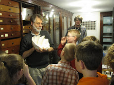 Dr. Tim Pearce and a Museum Mollusk