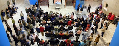 An overflow crowd hears humorist Sarah Vowell at the Cleveland Public Library