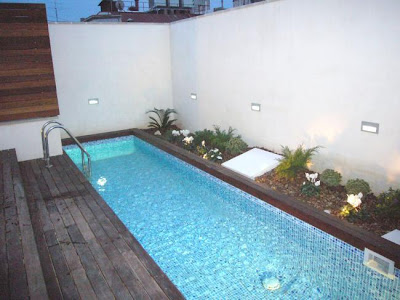 Aticos unicos en bcn for Piscina hinchable terraza atico