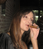 Annette White smoking a cigar