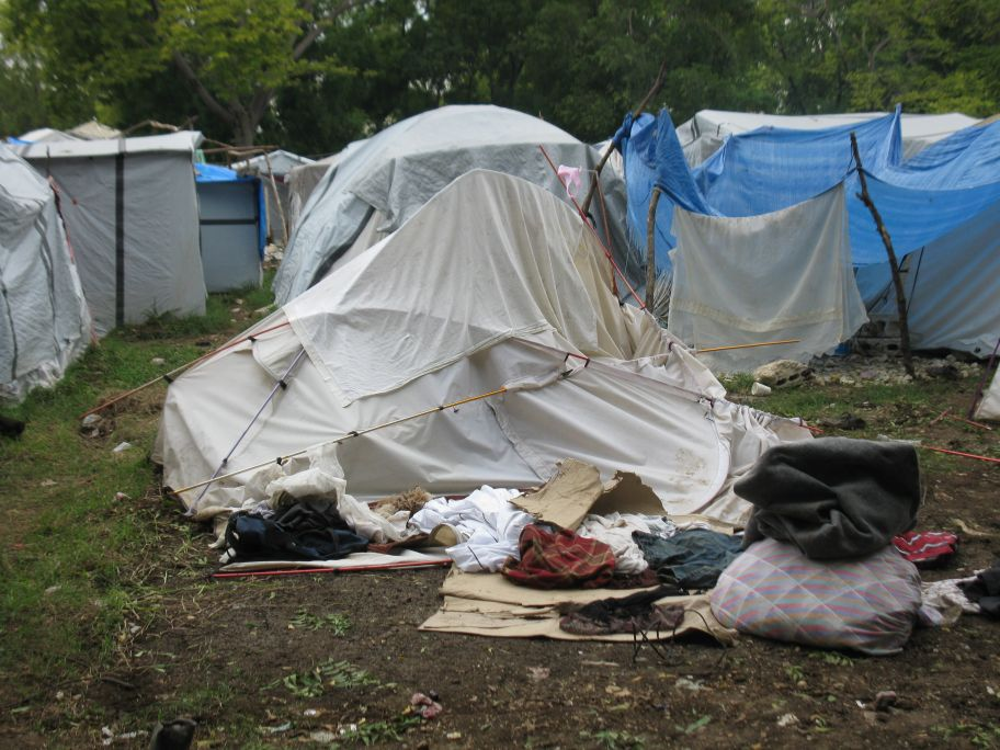 People whose tents were broken or damaged are moving in with friends in other tents cramming the tents even further. & HAITI - CORAM DEO: September 2010
