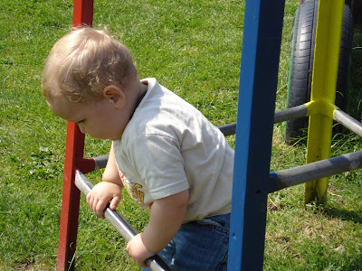 Baby Boy having a climb on a climbing frame