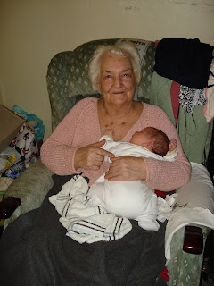 My Gran holding Baby Boy whilst wrapped up in her blanket
