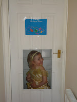 Sign on Bathroom door saying The Royal Throne and a picture of Top Ender looking over her shoulder