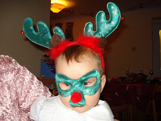 Baby Boy with Reindeer Mask and Antlers