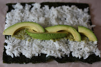 open peanut avocado sushi roll before rolling