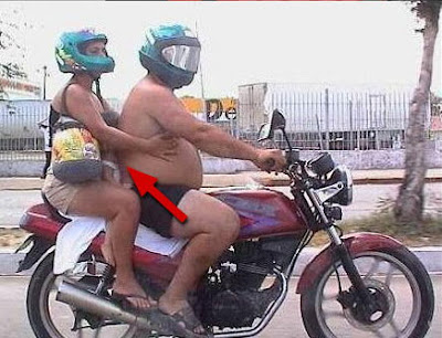 kid-sandwhiched-btwn-2-fatties-on-motorcycle.jpg