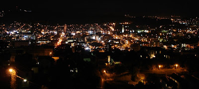View of the city at night from the balcony