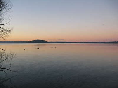 The sun setting over lake Rotorua