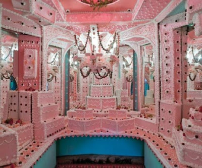 A room decorated by pink cake frosting