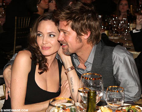 brad pitt and angelina jolie twins have down syndrome. ANGELINA JOLIE AND BRAD PITT