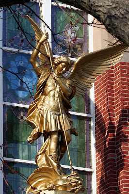 Statue of Saint Michael The Arch Angel above the entry door of Saint Michael Church