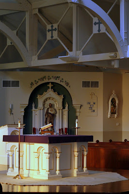 High Alter with Liturgy book and St. Joseph Altar in Background