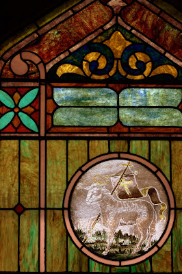 Worn Stained Glass Window of the Lamb of God