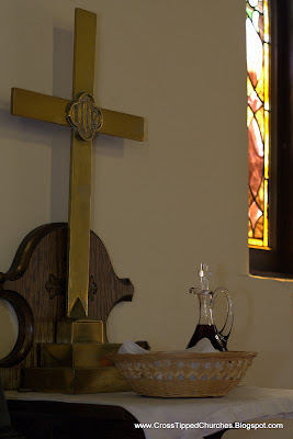 Crucifix, anoiting oil vessle and other sacraments.