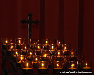 Grouping of tea lights and cross.