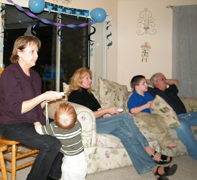 family playing wii women