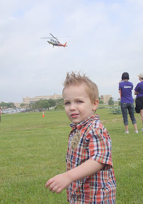 child pointing at helicopter