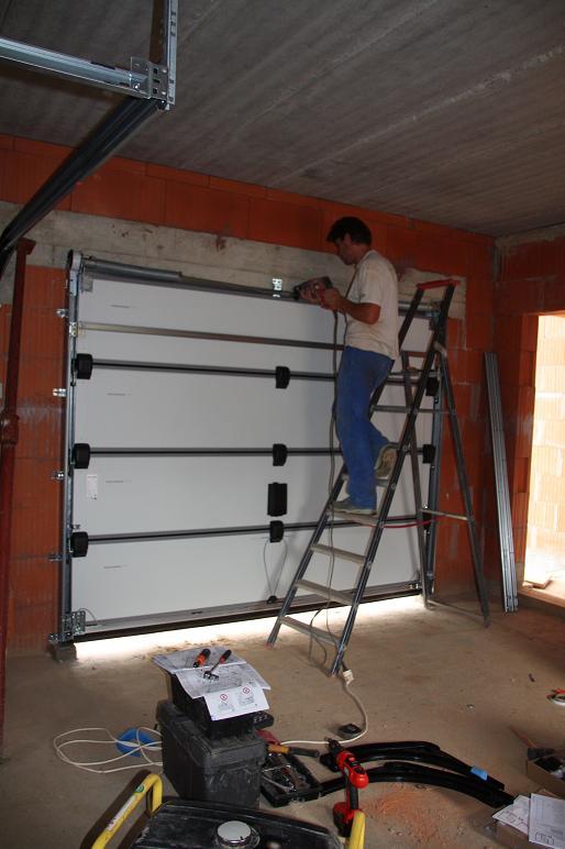 Autoconstruction de notre maison portes du garage for Porte de garage grise la rochelle