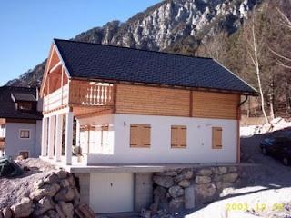 Progetti di case in legno casa 138 mq terrazza 16 for Piani di casa in collina con garage sottostante