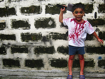 Asian boy dressed in bloody halloween costume