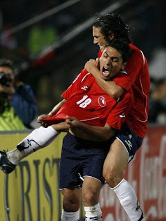 Chile's players celebrating another goal as they crush Colombia 4-0 at home