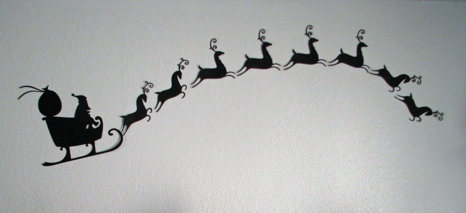 Santa And Reindeer Silhouette Images & Pictures - Becuo
